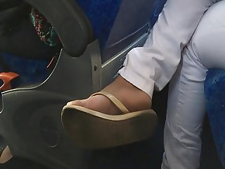 Candid Ebony Foot in bus flip flops