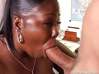 Busty mature black BBW gives a super sloppy blowjob