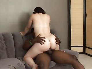 Sexy brunette wraps her lips around hung black studs huge hard cock