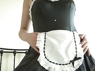 Brunette wears frilly, seductive maid's uniform.. ooo spank me!