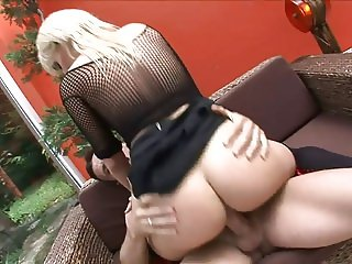 Blonde MILF in sexy gear rides cock reverse cowgirl
