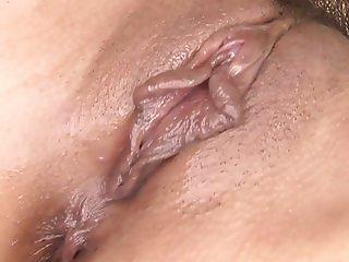 Masked bitch is giving a sexy brunette a senusla massage