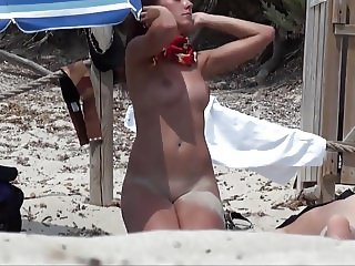 hidden cam of young nude woman on the beach