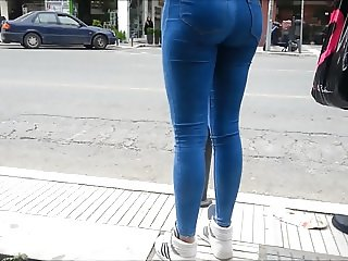 Candid: Young long legs in tight blue jeans