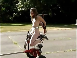 Humiliated whore machine fucking in public