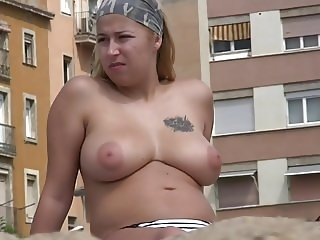 Busty blonde with ugly tattoo topless on the beach