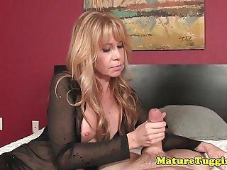 Glam busty milf giving sensual handjob