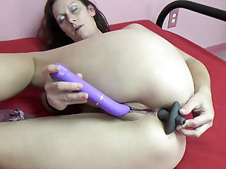 Horny housewife Trisha Delight stuffs both holes with toys