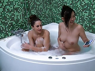 Interracial lesbian sex in a hot tub