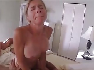 Mature hotwife rides lover while hubby videotapes