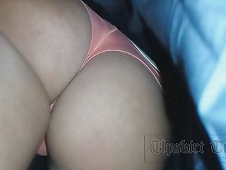 Upskirt beauty in pink panties.